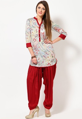 White/red coloured, Ikat printed patiala suit set for women by Ayaany. The kurta measures 34 inches in length and a mandarin collar. Both the kurta and patiala are made from cotton and features regular fit. With a creative blend of colourful abstract print all over the white/red base, this kurta from Ayaany promises to be the most fashionable pick this season. The matching red patiala with it makes this kurta more appealing.