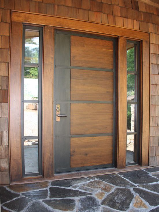 Contemporary front door of stained wood and rolled steel