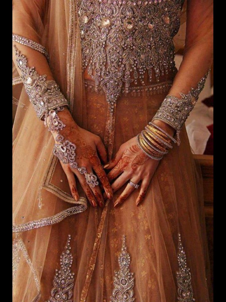 South Asian bride, bridal jewelry, henna, engagement ring, nude colored lehenga