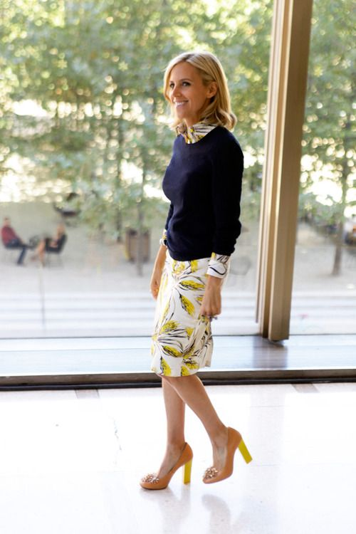 Tory Burch layers a chic sweater over a printed dress from her S/S 13 collection