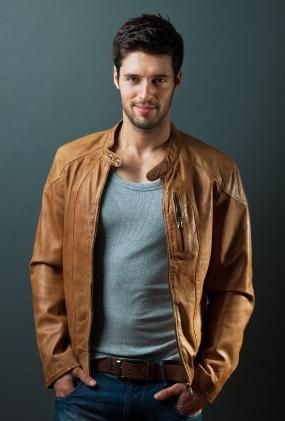 Men's Fashion: Tan Leather Jacket, Grey Crew Neck & Jeans.
