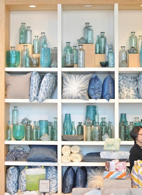 25 best ideas about furniture store display on pinterest for Glass bottle display ideas