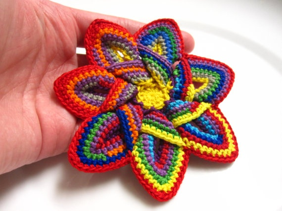 Crochet applique flower / star design - either to buy ready-made or use the pattern to make your own:  http://www.etsy.com/listing/121140632/crochet-applique-pattern-crochet-flower  |  from Heidi on Etsy
