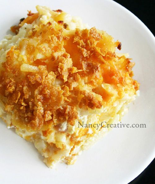 Cheesy Hash Brown Potatoes ~~ 2 lbs. frozen hash browns, thawed - 3/4 cup  (1 1/2 sticks) butter, melted and divided - 1/4 teaspoon pepper - 1 teaspoon salt - 1/2 cup chopped onion - 1 (10 3/4-ounce) can cream of chicken soup - 1 pint (2 cups) sour cream (regular or light) - 2 cups grated sharp cheddar cheese - 2 cups crushed corn flakes
