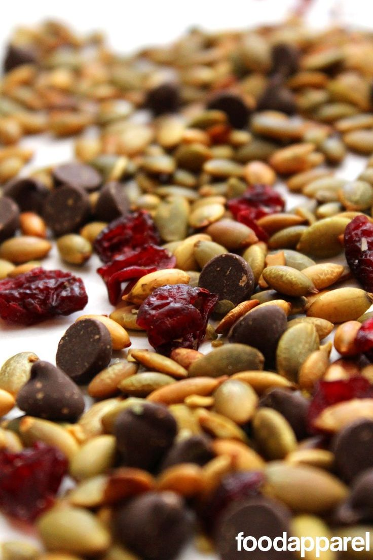 Mix-up boring trail mix by throwing together pepitas (pumpkin seeds), dried cranberries, and, of course, a hint of chocolate! Yummy and healthy option for snacking!