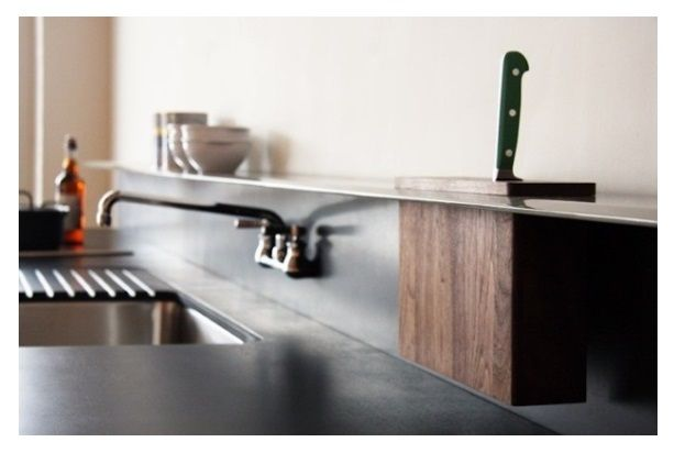 A useful thin steel shelf that runs the length of the counter and allows for an inset knife block.