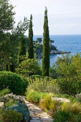 Clive Nichols - Corfu - Greece, the use of the Pencil pines is inspirational , they are like exclamation marks in the garden.