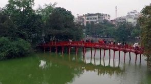 """Hoan Kiem Lake ( meaning """"Lake of the Returned Sword"""" or """"Lake of the Restored Sword""""), also known as Hồ Gươm (Sword Lake), is a lake in the historical center of Hanoi, the capital city of Vietnam. The lake is one of the major scenic spots in the city and serves as a focal point for its public life."""