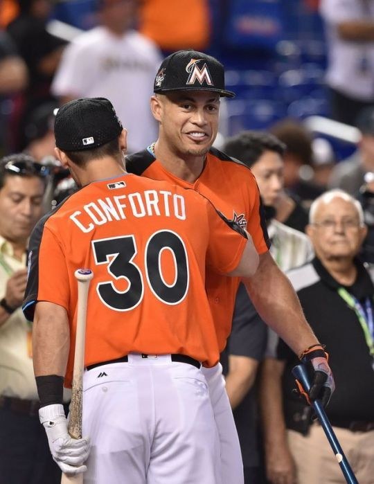 Giancarlo Stanton of the Miami Marlins greets Michael Conforto of the New York Mets during batting practice one day before the 2017 MLB All Star Game on July 10, 2017 at Marlins Park. (Credit: Steve Mitchell / USA TODAY Sports)