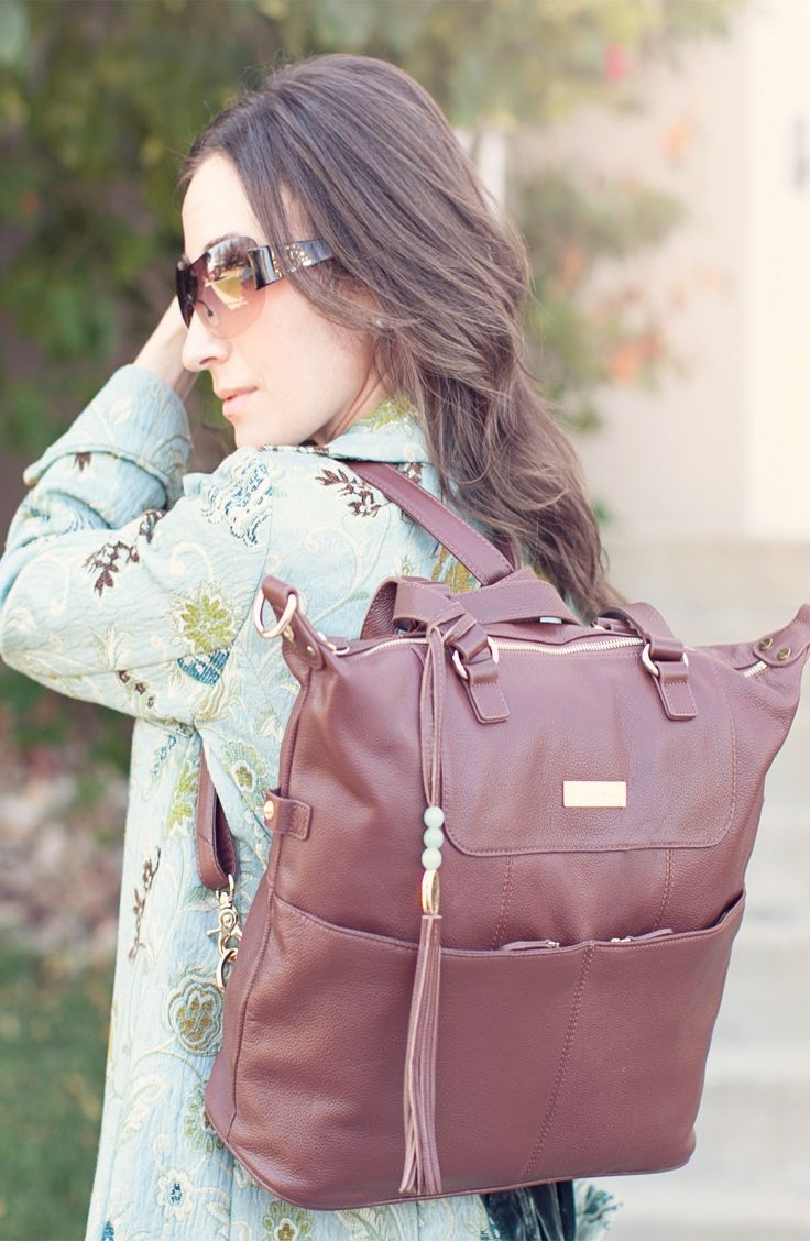It's all about the bag. Seriously. The Shaylee from Lily Jade is all you could ever want. Big enough to store what you need, compact enough not to be too bulky. Can be worn as a backpack, on the shoulder or crossbody. Features easy-to-access outer pockets