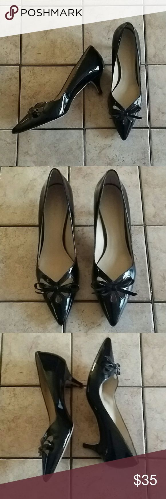 "Joan & David Blk Patent Leather Pumps, Sz 9.5M A beautiful pair of Joan & David black patent leather pumps, Sz 9.5 Medium, open flower design w/bow, and a comfortable 2"" heel. These are in excellent used condition, with normal wear on the bottom, and no marks/scratches/scuffing. Joan & David Shoes Heels"