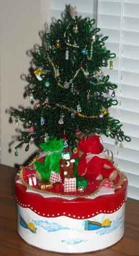 How to make beaded ornaments & garland for the tabletop beaded Christmas tree assembled in part 1. How to secure the tree in the stand, add skirt & toys.