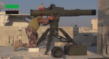 A Free Syrian Army 13th Division militant firing a BGM-71 TOW at a Syrian Arab Army target in Homs, Syria.
