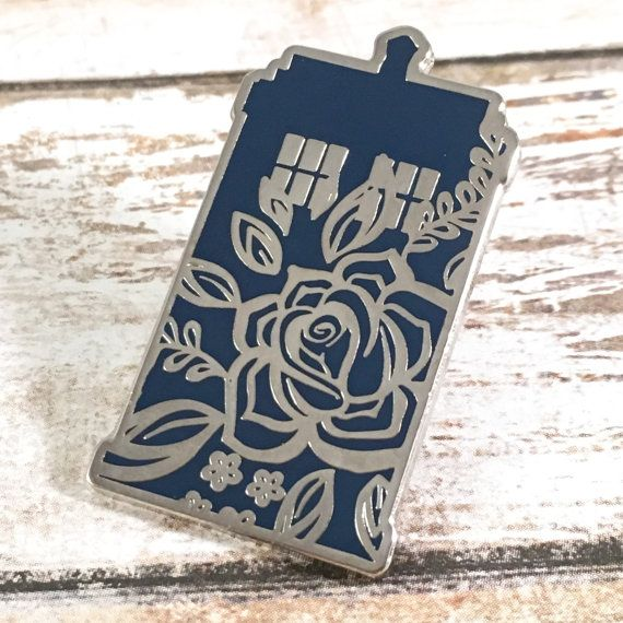 This pin is is a pretty twist on your typical TARDIS. The blue hard enamel is overlaid with a cute floral pattern. And if youre going to have something floral related to Doctor Who, it of course has to be a Rose. Rose Tyler did basically absorb all the information in the core of the TARDIS in her first season after all. So add this pin to your collection and make some vworp vworp vworp sounds to begin your travels. The pin measures 1.5 inches tall by 0.82 inches wide.
