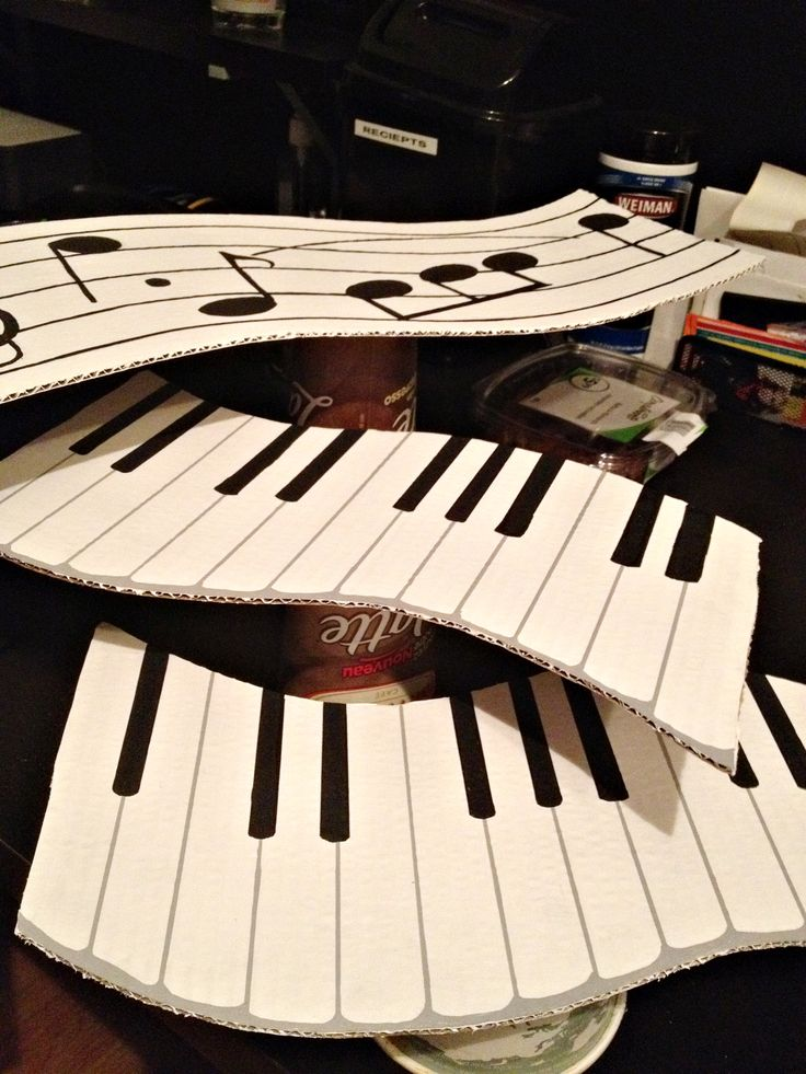 Music themed hors d'oeuvres. Made from cardboard and paint. Covered with seran wrap for temporary music themed party.
