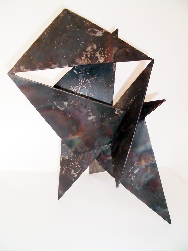 """""""Regatta"""" by Maurice Schlesinger. Welded steel sculpture 46x30x30cm covered with Estapol  """"Regatta"""" was inspired by the kaleidoskope of sails on Sydney Harbour on a race day. The juxtaposed angles suggest the kinetic energy of the wind while the light reflecting off the surfaces echoes sun dappled water. Maurice Schlesinger, sculptor"""
