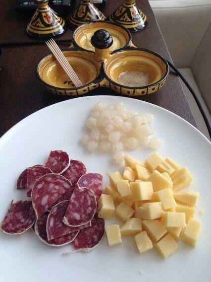 Chorizo, Emantale cheese, pickled onions, dijon mustard and celery salt x