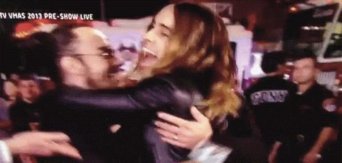 jared Shannon and Tomo hug after winning