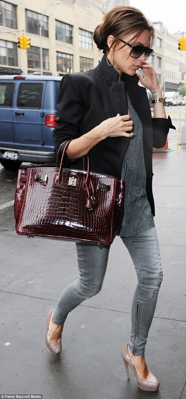 PETA is calling on Mrs Beckham, pictured in 2010 with a crocodile skin Hermès Birkin bag, ...