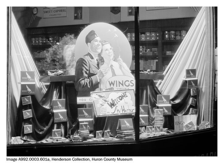 "Window display at Craigies Store, c. 1940. Craigies was located on The Square between Montreal and West streets in Goderich. The sign in the middle reads: ""Welcome to Sky Harbour Official Opening Monday October 14th, 1940."""