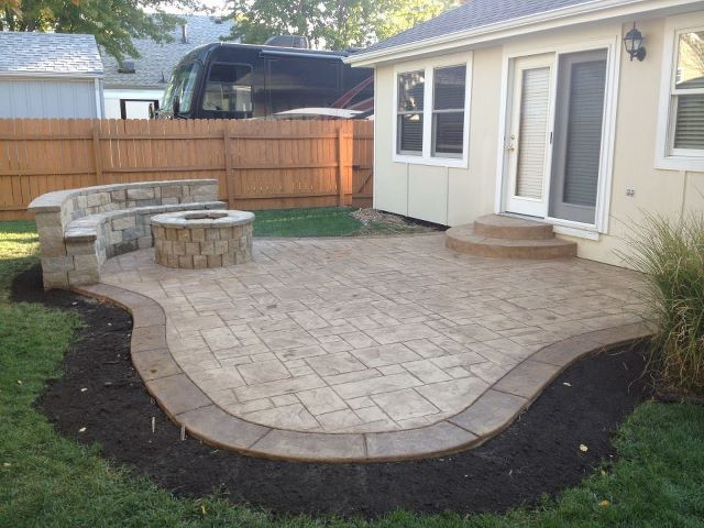 concrete patio with fire pit and sitting wallmaybe not the exact shape since itd have to fit our small boxy backyard plus my apple trees and garden - Design Backyard Patio