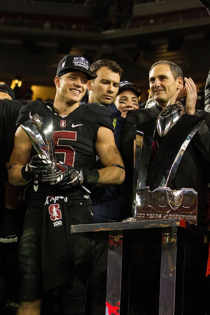 SANTA CLARA, CA - DECEMBER 05: Running back Christian McCaffrey #5 of the Stanford Cardinal is presented with the MVP trophy by commissioner Larry Scott after the Pac-12 Championship game against the USC Trojans at Levi's Stadium on December 5, 2015 in Santa Clara, California. The Stanford Cardinal defeated the USC Trojans 41-22. (2009×3013)