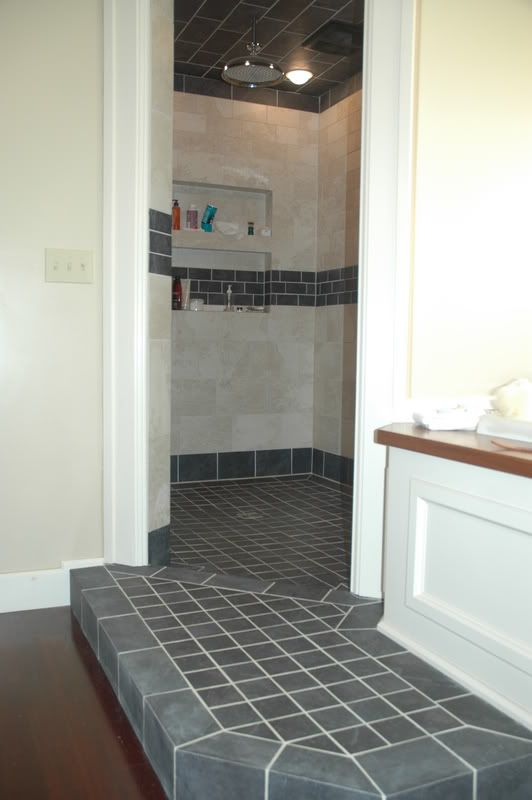 Step up to step down into this walk in shower no door - How to put down tile in bathroom ...