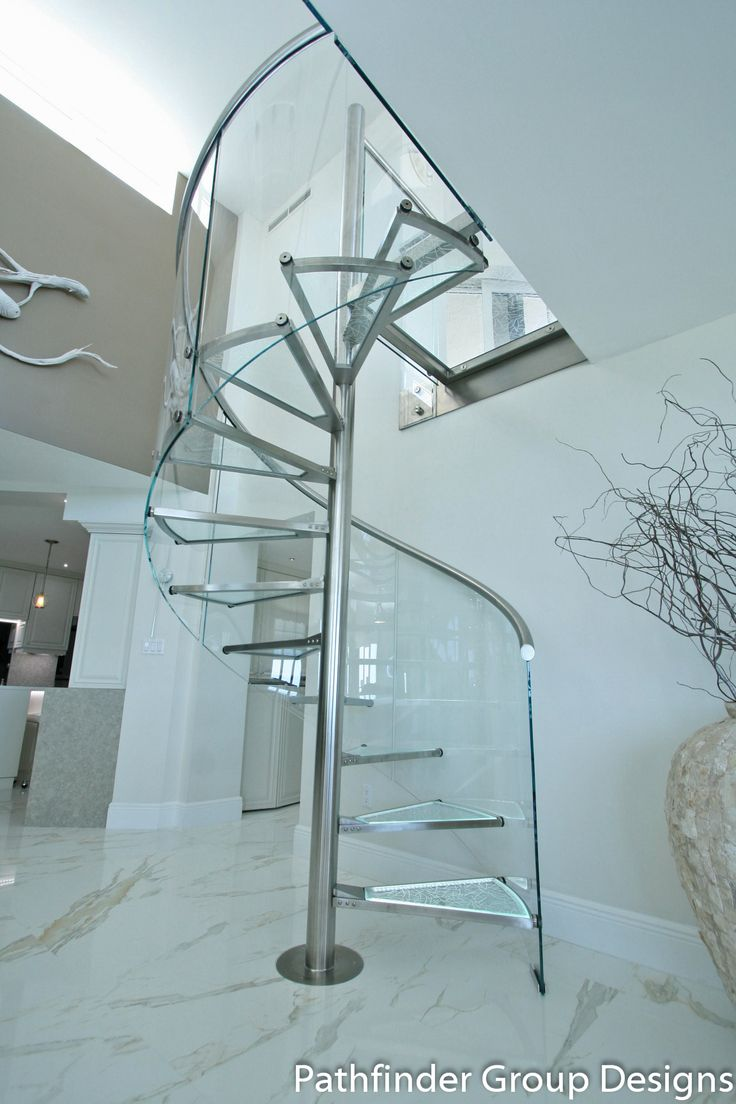 Renovated oceanfront Penthouse. Calacatta Porcelanosa flooring. Glass and steel spiral staircase with LED tread backlighting and curved glass railing.