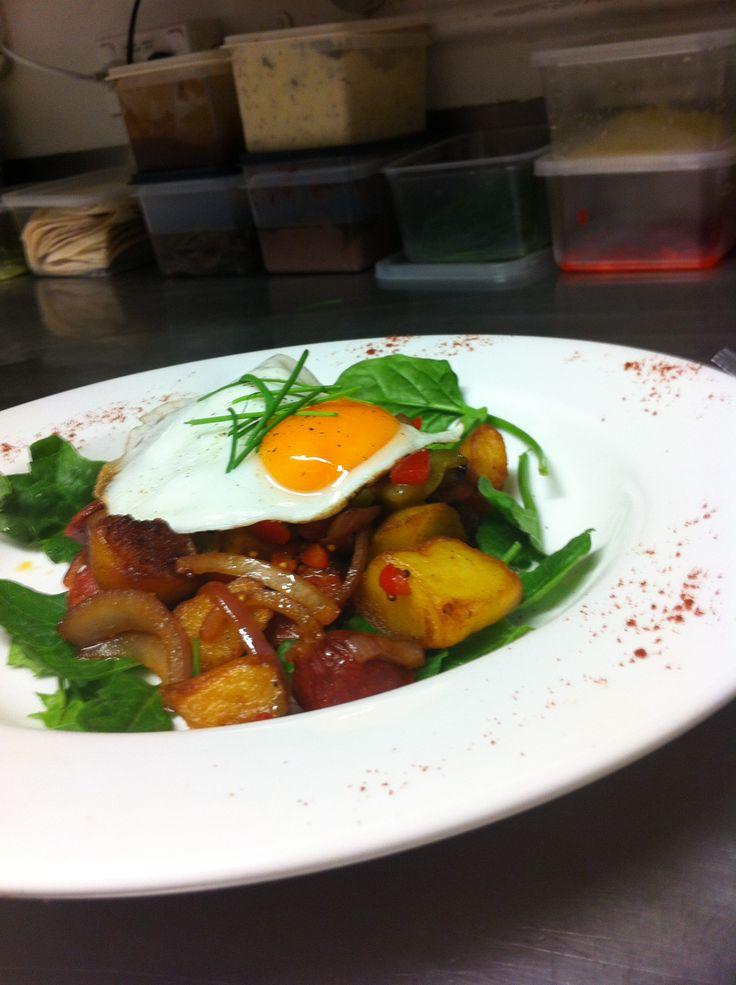 Mexican breakfast. Potato, chorizo, paprika, coriander and jalapeño on rocket with egg!! Boom!