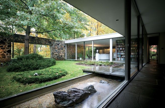 Marcel Breuer's Hooper House II in Baltimore, Maryland proves that wonderfully natural materials, like these flagstones used in the walls, are perfectly at home in Bauhaus geometry. The interior courtyard and view out to the landscape create a nice sense of intimacy while keeping the house in touch with its surroundings. Photo by Raymond Meier.