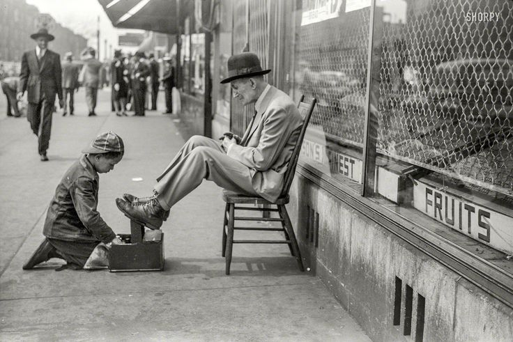 "April 1941. ""Shoeshine, 47th Street, Chicago's main Negro business street."" 35mm negative by Edwin Rosskam for the Resettlement Administration."