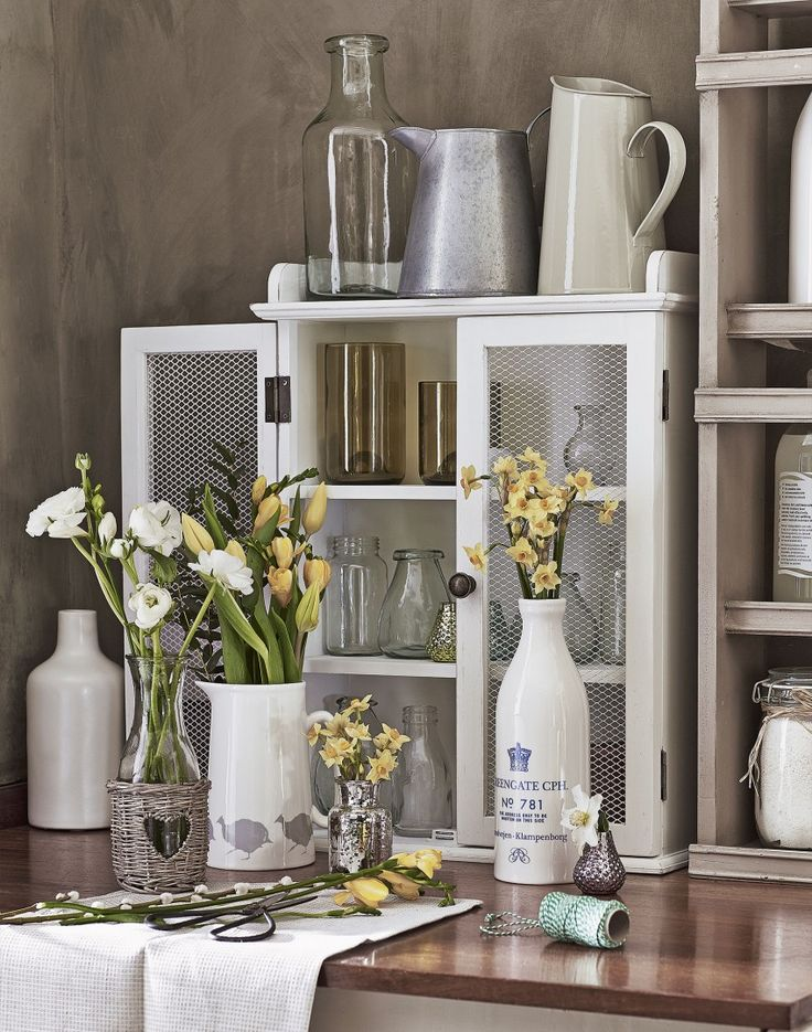Displaying a host of seasonal flowers will brighten up any space in the home. Ditch traditional vases in favour of vintage jugs, bottles and jars