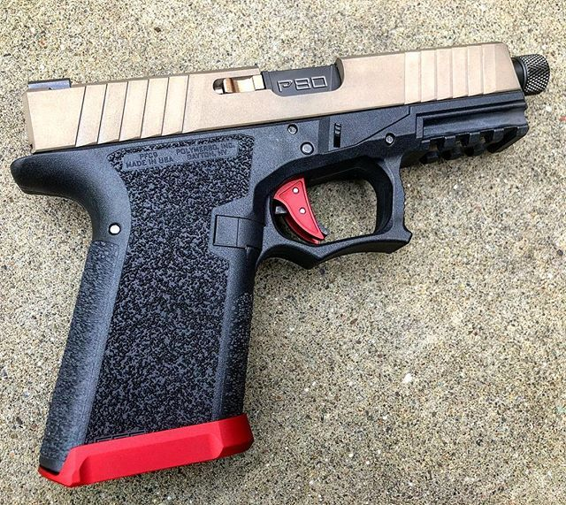 This black/FDE/red build really does it for us  What color