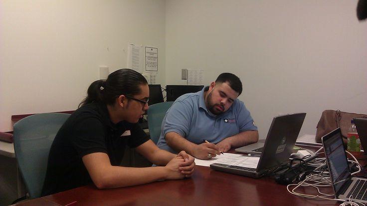 Project GRAD AmeriCorps College Success Member advising a GRAD Scholar during PG @ the U - Houston Community College Northline.
