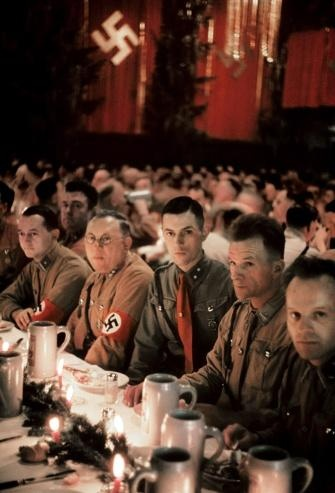 Nazi Christmas Party, Munich, 1941. The blank look in their eyes are haunting.