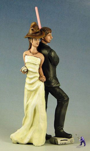 Geek Wedding Topper that would be awesome if she had a bow and arrow or the one ring somewhere