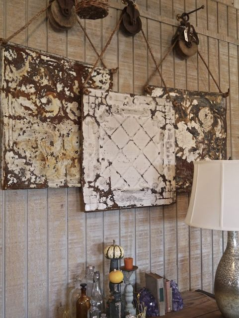 Beautiful old ceiling tiles hung on pulleys. Love this idea.