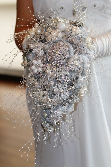 Vintage Brooch bouquet: like the idea of using twigs for a more earthy appeal…