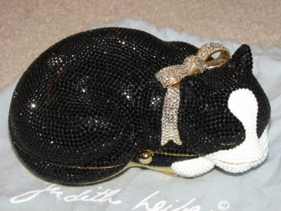 Judith Leiber has moved on to do so many wonderful bags, but I will always prefer the original sleeping cat.