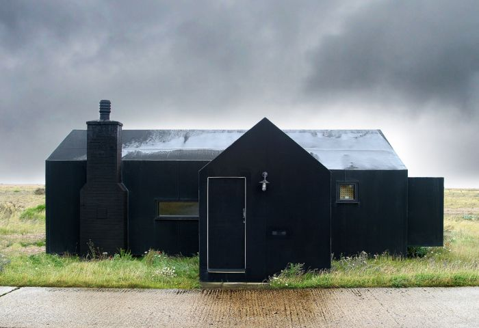 The black rubber house in Kent by Simon Conder Associates - use just front of this for studio/ w. glass front door and side glass wall looking to meadow