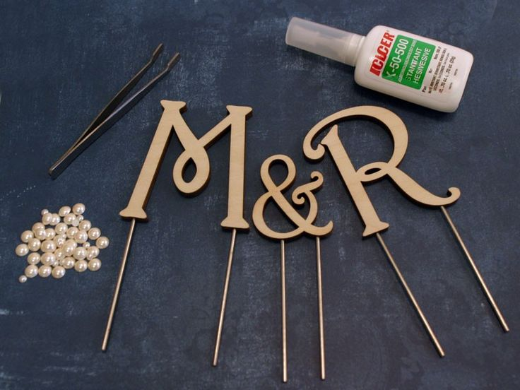 Great site for unpainted wood cake topper monograms that I can decorate to match my decor