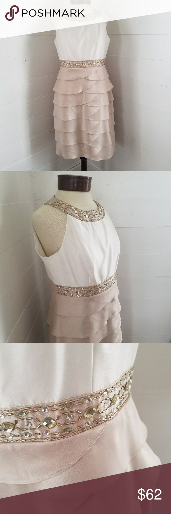 """NWT Jessica Howard Petite Evening Dress Jessica Howard Petite Dress. NWT. This shutter pleat dress is so beautiful for your next special occasion. Thw color is a shimmery ivory/beige embellish with beautiful beading and rhinestones. Lined. Very Flattering dress! Appox. Measurement: Length 36"""" Waist 16"""" Armpit to Armpit 18"""".  *M8 Jessica Howard Dresses"""