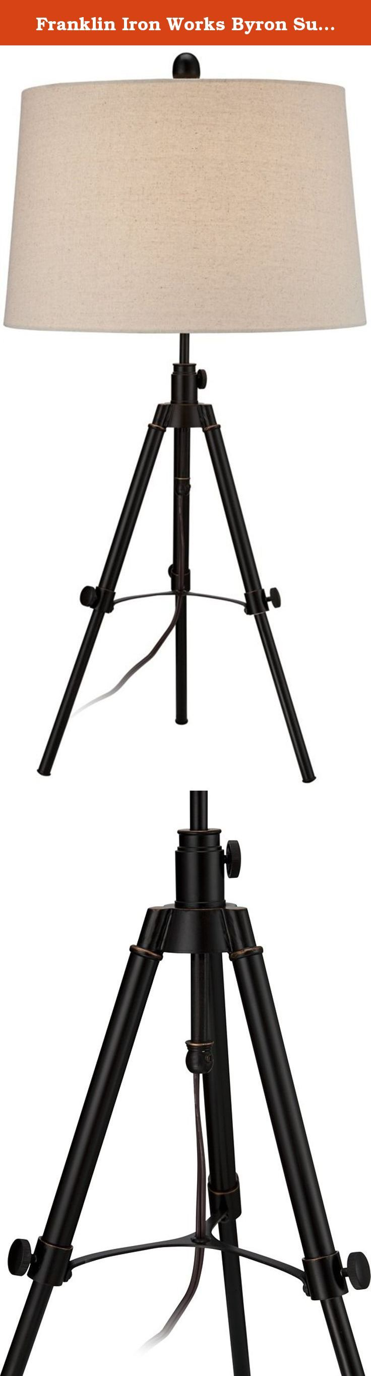 """Franklin Iron Works Byron Surveyor Table Lamp. Illuminate any space with this stylish transitional metal table lamp. The tripod base is topped with a beige drum shade that will match a variety of decor styles. From Franklin Iron Works. - Metal table lamp. - Design inspired by a telescope. - Drum lamp shade. - On/off switch. - Maximum 150 watt or equivalent bulb (not included). - 34"""" high. - Shade measures 14"""" across the top, 16"""" across the bottom, 10"""" on the slant."""