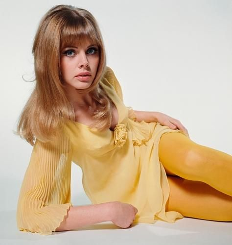 "Britt Ekland Yellow Dress 2 photographed by Terry O'Neill  Swedish actress Britt Ekland in a yellow dress and matching tights, circa 1964.  Limited Edition C-Print Signed and Numbered Sizes:  16"" x 16"" / 20"" x 20""  24"" x 24"" / 30"" x 30""  40"" x 40"" / 48"" x 48"" / 60"" x 60"" / 72"" x 72""  For questions or prices please contact us at info@igifa.com      IGI FINE ART"