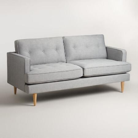 This is the one I mentioned. It looks more blue in person. Dove Gray Woven Apel Sofa | World Market
