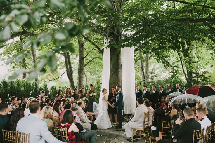 Outdoor ceremony at the grand victorian, flower garland instead of fabric.