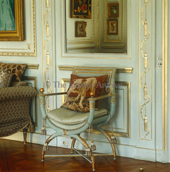 Duke & Duchess of Windsor's Paris home ~ In the main salon a painted and gilded Empire armchair exactly matches the eau de nil of the panelling behind and is accompanied by a cushion depicting a British bulldog...