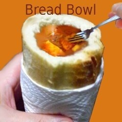 I first tasted a bread bowl in east Berlin Germany in the 90's on the corner of a cold snowy street an Imbiss or Schnellimbiss - fast food stand....