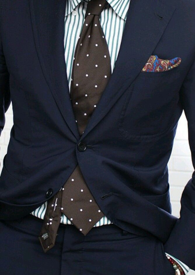 Navy suit, white shirt with green candy stripes, brown tie with white polka dots