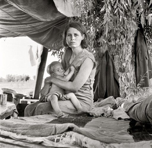 "August 17, 1936. Blythe, California. ""Drought refugees from Oklahoma camping by the roadside. They hope to work in the cotton fields. There are seven in family. The official at the border inspection service said that on this day, 23 carloads and truckloads of migrant families out of the drought counties of Oklahoma and Arkansas had passed through from Arizona entering California."" Medium-format negative by Dorothea Lange for the Resettlement Administration."